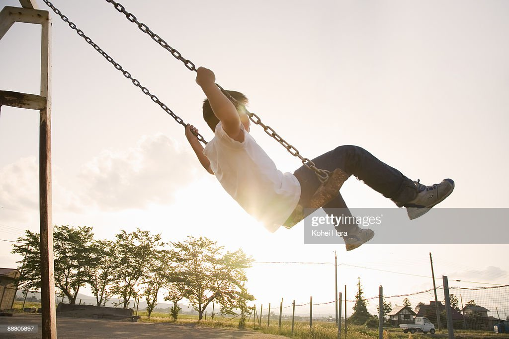 boy going on a swing