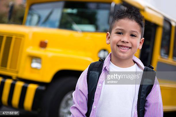Boy going to school by bus