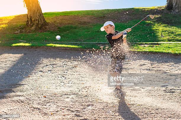 Boy Golfer Hitting Out A Sand Bunker
