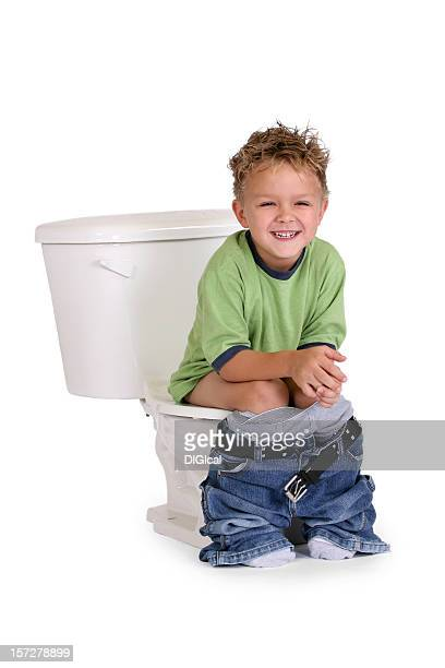 Boy Grining While He Is On The Toilet