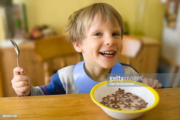 Boy Grinning at Breakfast