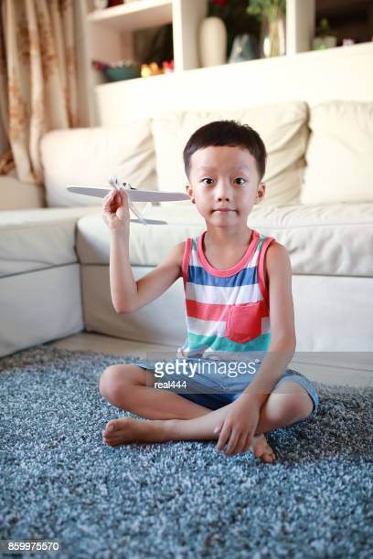 Boy hand holding a toy plane