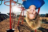 Boy hanging upside down.