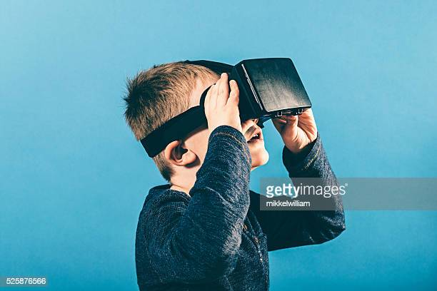 Boy has an immersive experience with VR glasses