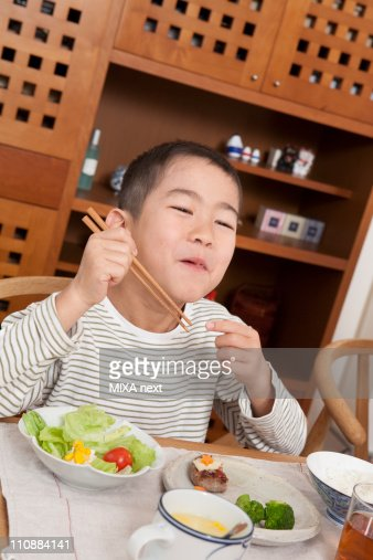 Boy Having a Meal by Chopsticks : Stock Photo