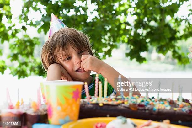 Boy having cake at birthday party