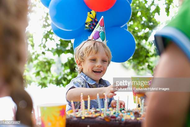 Boy having drink at birthday party