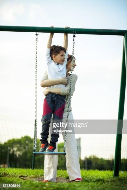 Boy having fun on a swing