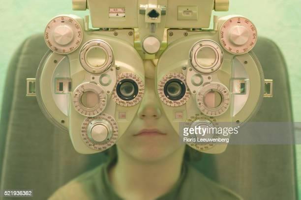 A Boy Having His Eyes Examined