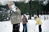 Boy having snow thrown at him
