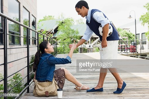 Boy helping girl up