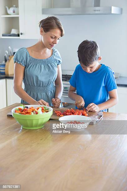 Boy helping his mother to prepare food