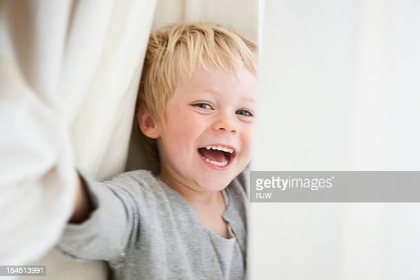 Boy Hiding in Curtain