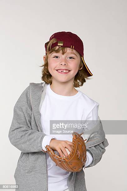 Boy holding a baseball and a baseball glove