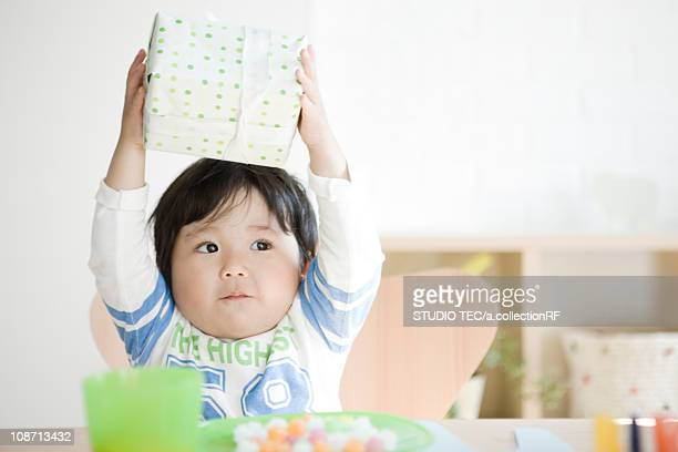 Boy holding a birthday present