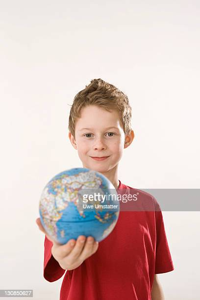Boy holding a globe in his hand