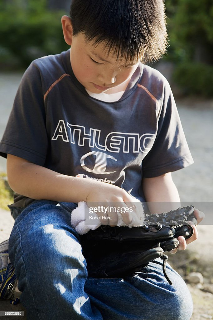 boy holding a glove : Stock Photo