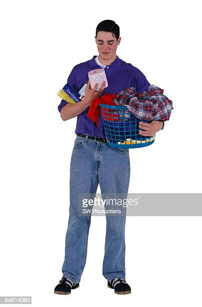 Boy Holding a Laundry Basket and Cleaning Supplies