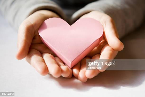 boy holding a pink heart