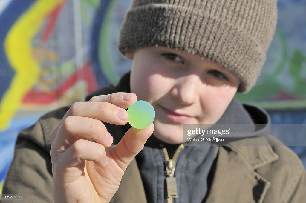 Boy, 10, holding a rubber ball, Germany, Europe : Stock Photo