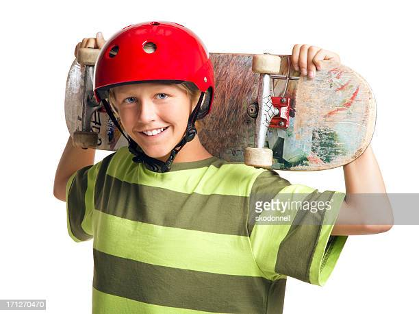 Boy Holding a Skateboard on the White Background