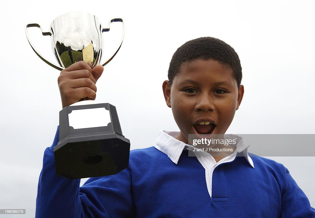 Boy holding a trophy : Stock Photo