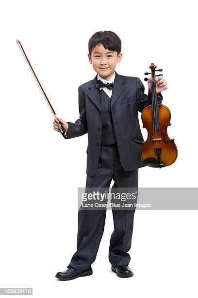 Boy holding a violin