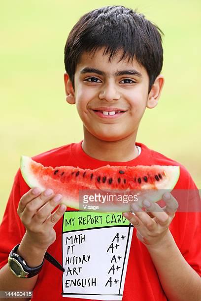 Boy holding a watermelon