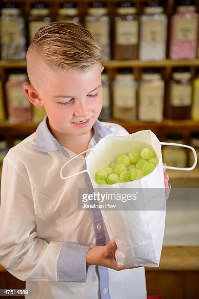 Boy holding bag of confectionery