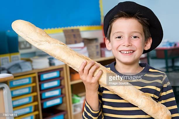 Boy holding baguette