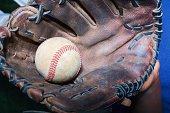 Boy holding baseball in a baseball glove