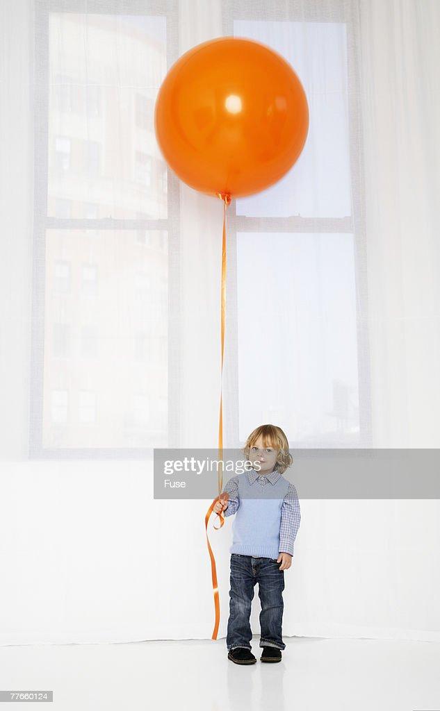 Boy Holding Big Balloon : Stock Photo