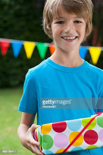 Boy holding birthday present