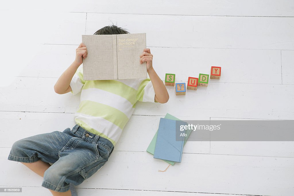 Boy Holding Book : Stock Photo