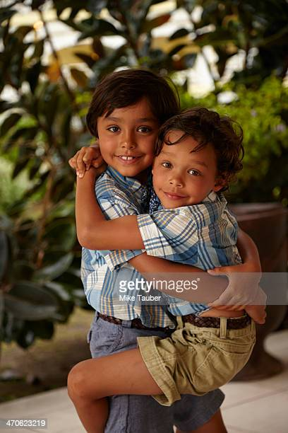 Boy holding brother on porch