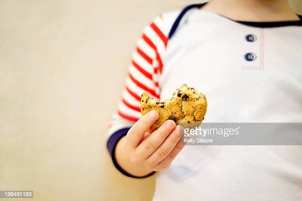 Boy holding cookie