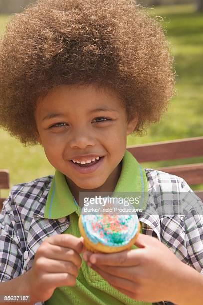 Boy holding cupcake