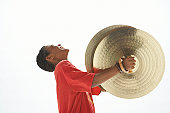 Boy (9-11) holding cymbals, head back, eyes closed, side view