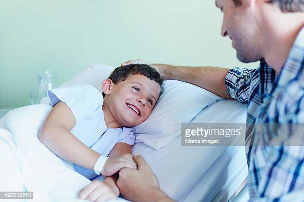 Boy holding father's hand
