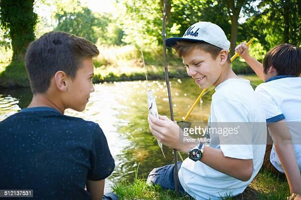 Boy holding fish