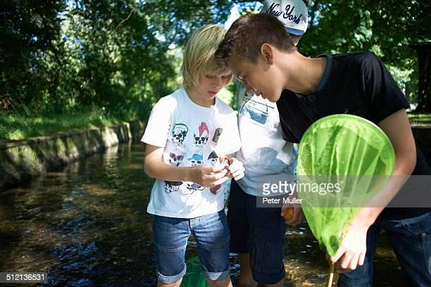 Boy holding fishing net