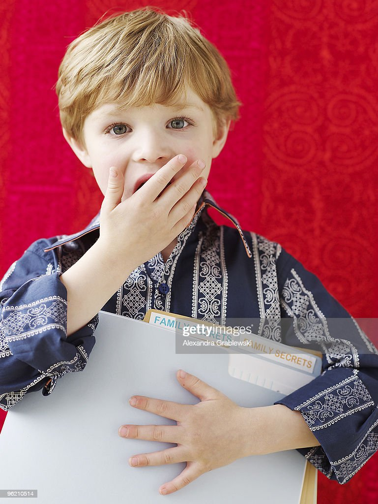 Boy Holding Folders of Family Secrets : Stock Photo