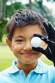 Boy Holding Golf Ball