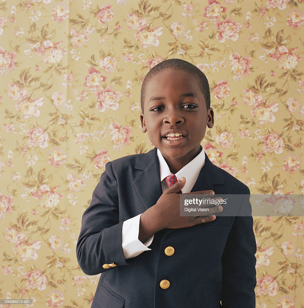 Boy (9-11) holding hand to chest, portrait : Stock Photo