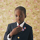 Boy (9-11) holding hand to chest, portrait