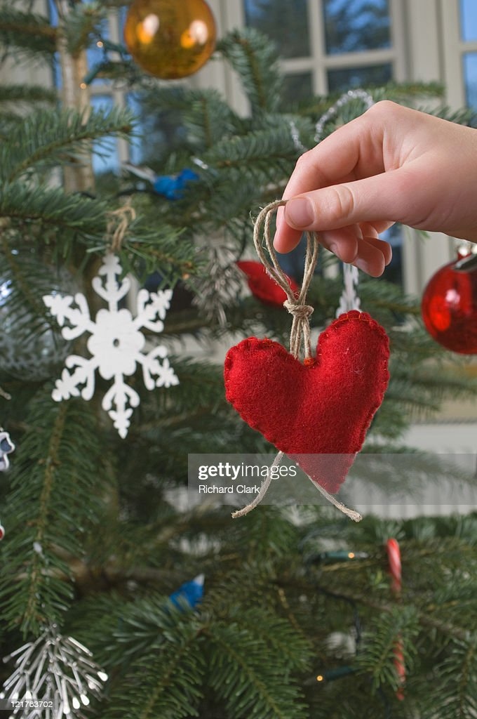 Boy holding heart shapped christmas decoration : Stock Photo