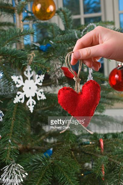 Boy holding heart shapped christmas decoration