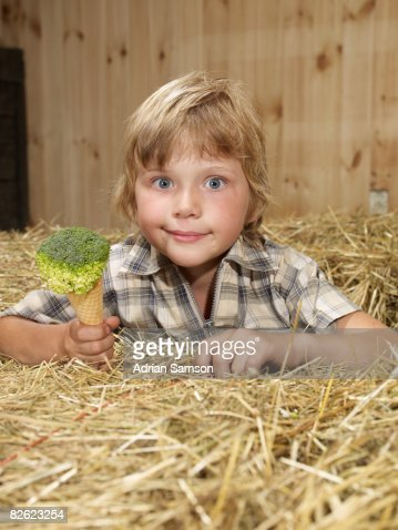 Boy holding 'ice cream' made from broccoli : Stock Photo