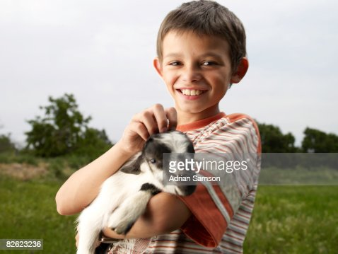 Boy holding kid : Stock Photo