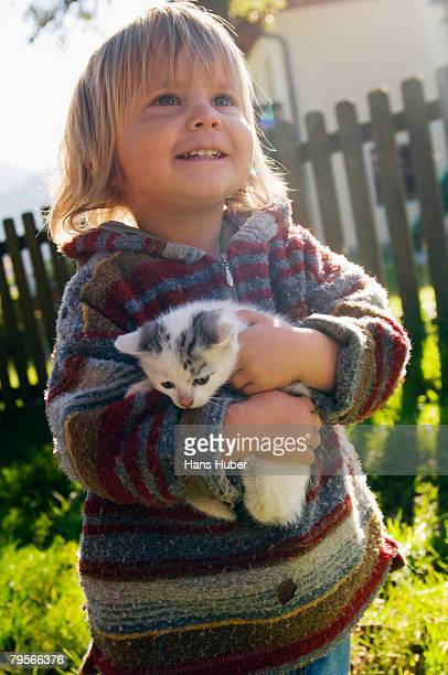 'Boy holding kitten, portrait'